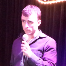 Comedian Andy Hartley on stage